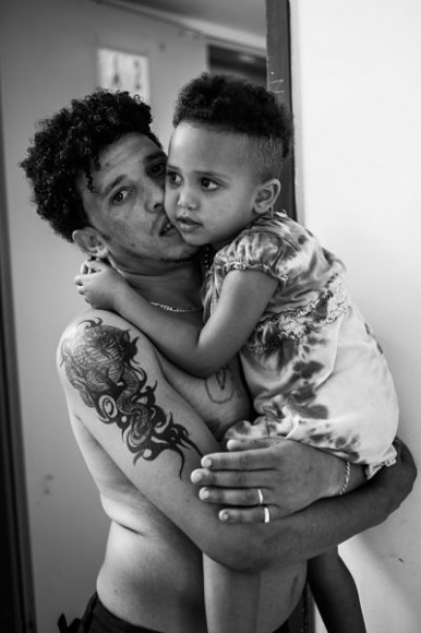 an Eritrean man with his daughter